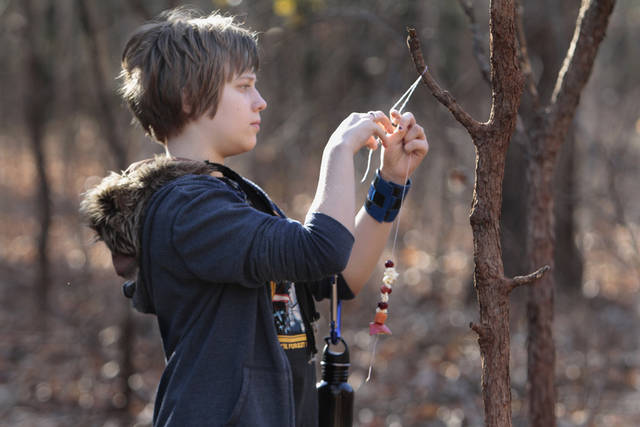 Chloe Russess, 13, hangs her hand made bird feeder in Martin Park during a free class on Saturday, Dec. 17, 2011, in Oklahoma City, Okla.   Photo by Steve Sisney, The Oklahoman