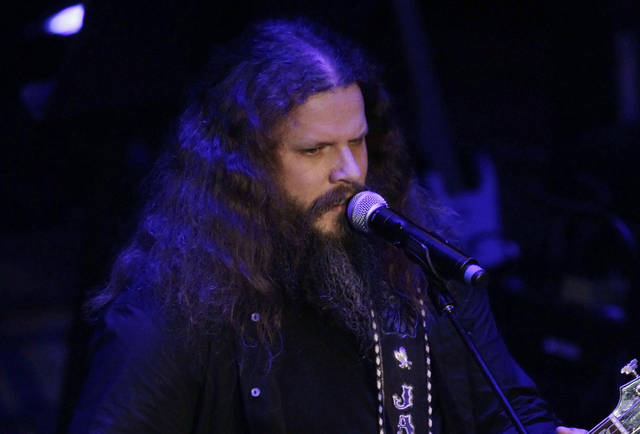 "Jamey Johnson performs during the 2011 Academy of Country Music Honors show in Nashville, Tenn. Johnson pays tribute to Hank Cochran with the release this week of ""Living for a Song: A Tribute to Hank Cochran,"" a deep look at the songwriter's career. AP Photo"