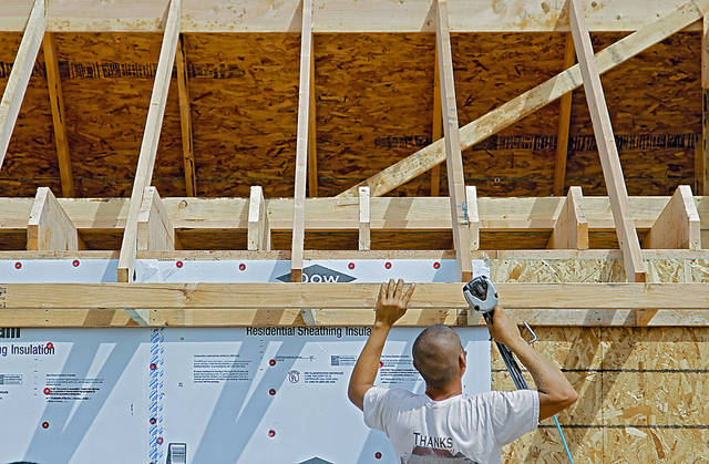 A 4Corners Homes crew member works on a new home for Stephanie Jones during Central Oklahoma Habitat for Humanity's Builders Blitz this week in the Hope Crossing addition at NE 83 and N Kelley Avenue. 4Corners and Moore-based Home Creations are participating in the Builders Blitz.