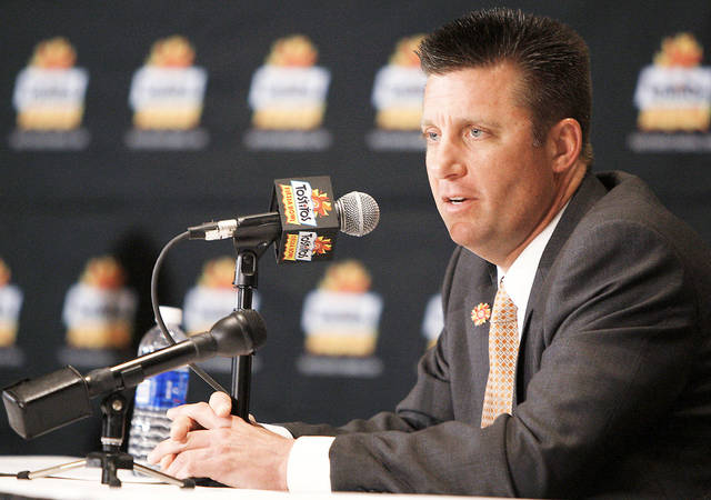 Oklahoma State coach Mike Gundy and the Cowboys were on the outside looking in last season when it came time for the national championship game, but that system will change in the future. Gundy said he thinks a smaller committee for choosing playoff teams in the new system would work better. Photo by Bryan Terry, The Oklahoman
