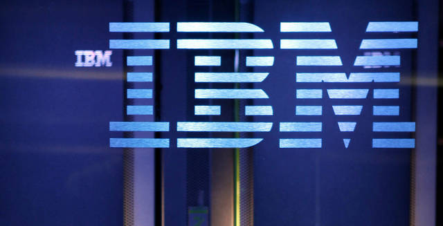 FILE - In this file photo taken Jan. 13, 2011, the IBM logo is displayed on hardware for an IBM computer known as &quot;Watson&quot; in Yorktown Heights, N.Y., after a practice round of the &quot;Jeopardy!&quot; quiz show. IBM will begin making lump-sum matching contributions to employees&#039; 401(k) accounts on an annual basis, rather than contributing each time a worker gets a paycheck, the company announced Friday, Dec. 7, 2012. It&#039;s a move that will help the technology company cut retirement benefits costs. (AP Photo/Seth Wenig, File)