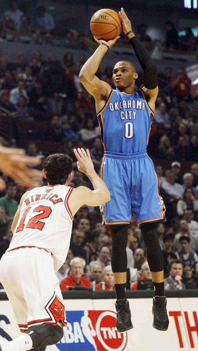 Oklahoma City Thunder guard Russell Westbrook (0) shoots over Chicago Bulls guard Kirk Hinrich (12) during the first half of an NBA basketball game, Thursday, Nov. 8, 2012, in Chicago. (AP Photo/Charlie Arbogast) ORG XMIT: CXA103