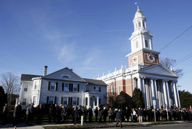 A long line stretches down the block in front of the First Congregational Church before a memorial service for Lauren Rousseau in Danbury, Conn., Thursday, Dec. 20, 2012.   Rousseau, 30, was killed when Adam Lanza walked into Sandy Hook Elementary School in Newtown, Dec. 14, and opened fire, killing 26 people, including 20 children, before killing himself.  (AP Photo/Seth Wenig)