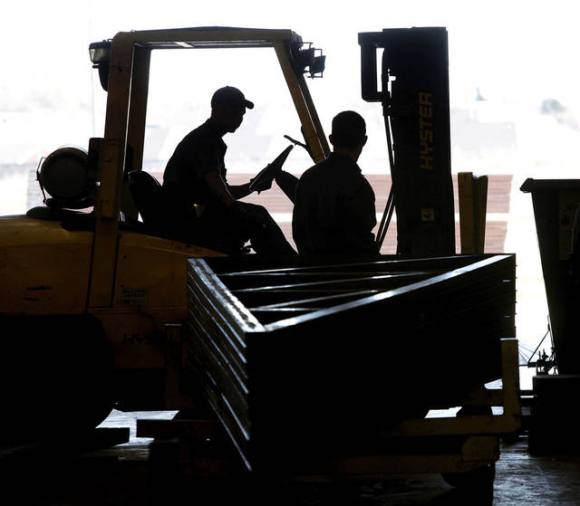 Workers move a pallet of assembled metal frames at  Indaco Metals, in Shawnee.  Photo taken Tuesday,  March 13, 2012.   Photo by Jim Beckel, The Oklahoman