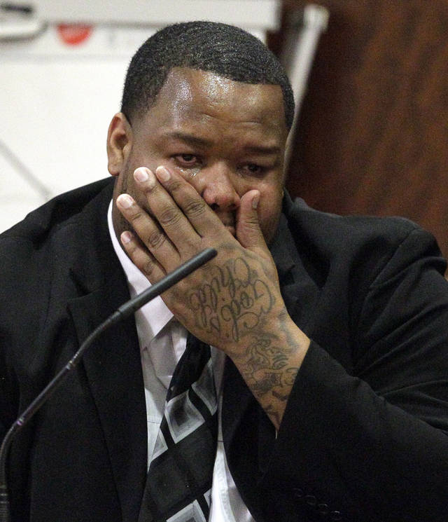 Suspended Green Bay Packers football player Johnny Jolly wipes away tears as he testifies in court Thursday, Nov. 17, 2011, in Houston. Jolly was sentenced to six years in prison for violating the terms of his probation on a drug charge. He was charged with possession of a compound containing codeine and tampering with evidence after a traffic stop in October. It was his third drug arrest in three years. (AP Photo/David J. Phillip)