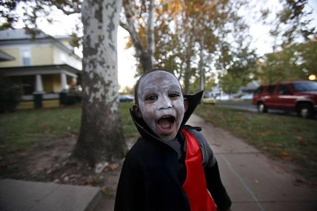 Roderick Norwood Jr., 2, trick or treats, Saturday Oct. 30, 2010, in the Mesta Park  Neighborhood in Oklahoma City. Photo by Sarah Phipps, The Oklahoman