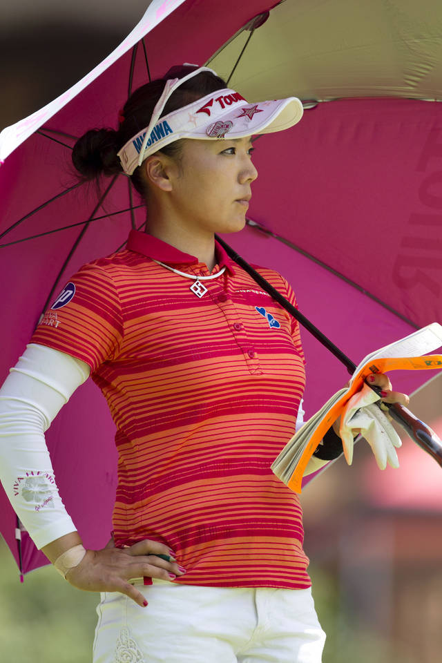 Chie Arimura, of Japan, waits to hit off the third tee during the final round of the LPGA NW Arkansas Championship golf tournament on Sunday, June 23, 2013, in Rogers, Ark. (AP Photo/Beth Hall)