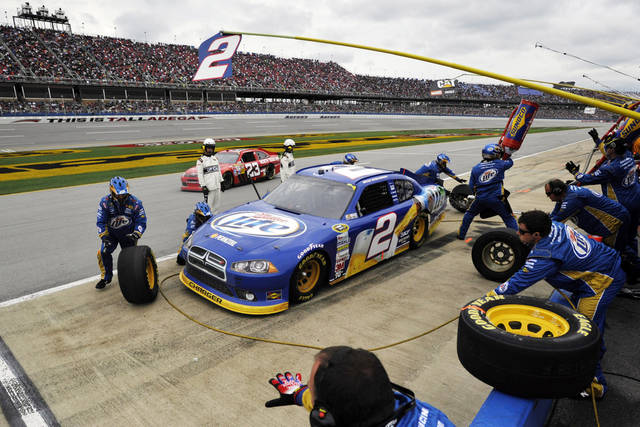 Brad Keselowski's crew works to service his car during the NASCAR Sprint Cup Series auto race at Talladega Superspeedway in Talladega, Ala., Sunday, Oct. 7, 2012. (AP Photo/Rainier Ehrhardt)