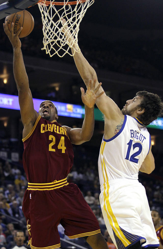 Cleveland Cavaliers forward Samardo Samuels (24) shoots against Golden State Warriors center Andrew Bogut (12), from Australia, during the first quarter of an NBA basketball game in Oakland, Calif., Wednesday, Nov. 7, 2012. (AP Photo/Jeff Chiu)