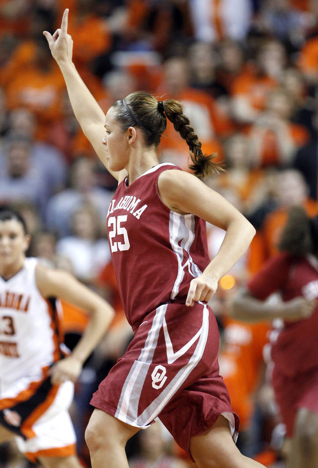 OU's Whitney Hand celebrates a Sooner score during the 2009 Bedlam game in Stillwater. PHOTO BY SARAH PHIPPS, The Oklahoman Archives