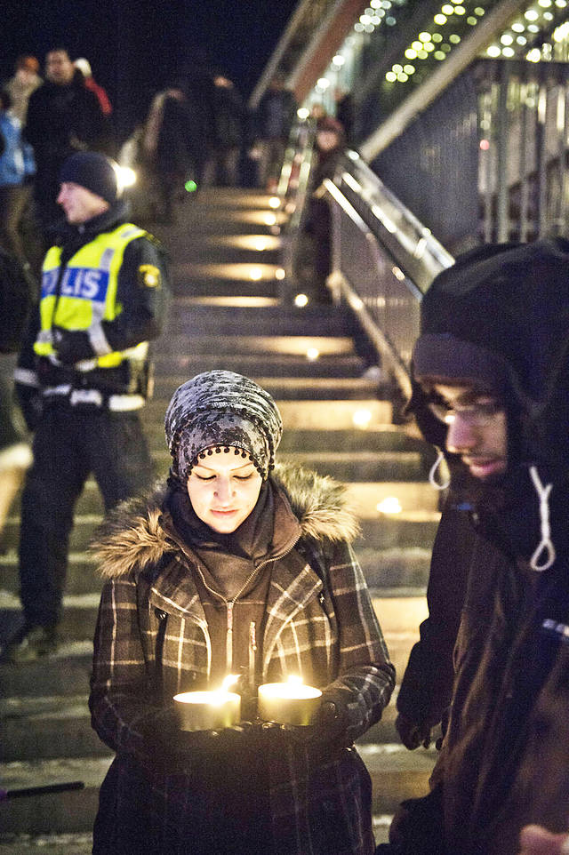 Sama Sarsour from Swedish Muslims for Peace and Justice (SMFR) participates in a peace demonstration Sunday at Sergel's square in central Stockholm.  AP PHOTO