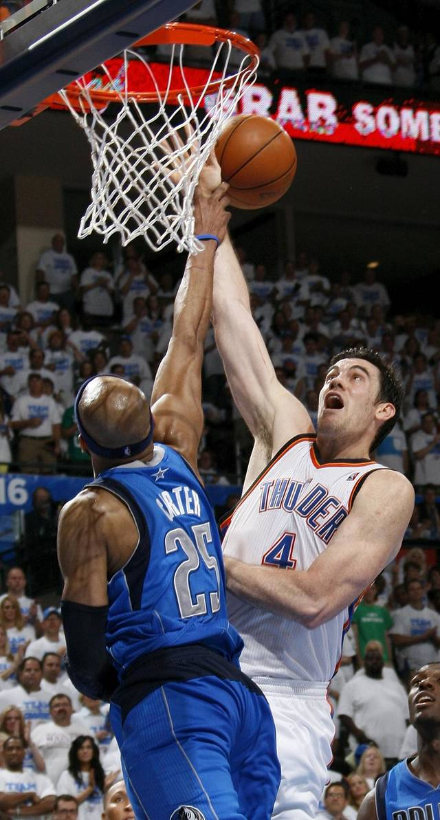 Oklahoma City's Nick Collison (4) has his shot blocked by Dallas' Vince Carter during Game 2 of the first round in the NBA basketball  playoffs between the Oklahoma City Thunder and the Dallas Mavericks at Chesapeake Energy Arena in Oklahoma City, Monday, April 30, 2012.  Oklahoma City won, 102-99. Photo by Nate Billings, The Oklahoman