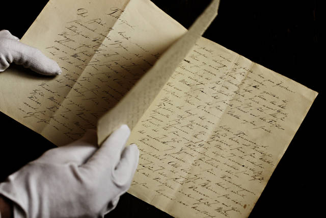 A newly found manuscript of a fairy tale by Hans Christian Andersen which has been located in Odense, pictured in the State Archives in Copenhagen,  Denmark  Wednesday, Dec. 12, 2012. The story of �The Tallow Candle� might have been written about 1823, when he was 18 year old. (AP Photo/POLFOTO, Martin Bubandt)  DENMARK OUT