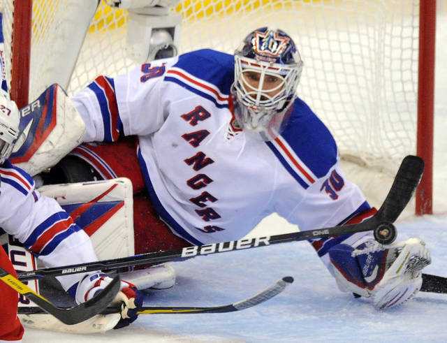 New York Rangers goalie Henrik Lundqvist makes a save against the Ottawa Senators during the second period of Game 6 of a first-round NHL Stanley Cup playoff hockey series, in Ottawa, Ontario, on Monday, April 23, 2012. (AP Photo/The Canadian Press, Sean Kilpatrick)