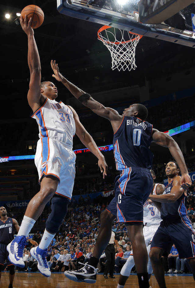 Oklahoma City's Daniel Orton (33) shoots over Charlotte's Bismack Biyombo (0) during the preseason NBA game between the Oklahoma City Thunder and the Charlotte Bobcats at Chesapeake Energy Arena in Oklahoma City, Tuesday, Oct. 16, 2012. Photo by Sarah Phipps, The Oklahoman
