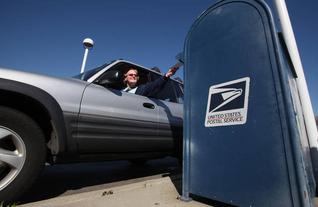 In this photo taken Feb. 24, 2012, mail is deposited into an outdoor postal box at the Sacramento Processing Center in West Sacramento, Calif. Elections officials in several states are concerned that the closing of mail-processing centers and post offices could disrupt vote-by-mail balloting this year.(AP Photo/Rich Pedroncelli)