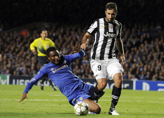Juventus' Mirko Vucinic, right, is tackled by Chelsea's John Obi Mikel during their Champions League group E soccer match at Stamford Bridge, London, Wednesday, Sept. 19, 2012. (AP Photo/Tom Hevezi)
