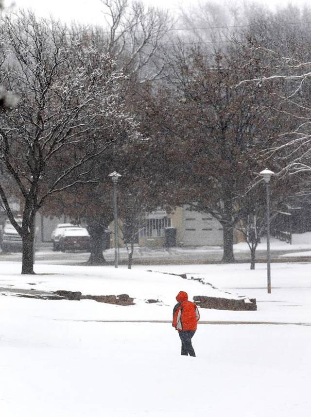 A person walks in the snow in northwest Oklahoma City Tuesday , Feb. 12, 2013.    Photo by Jim Beckel, The Oklahoman