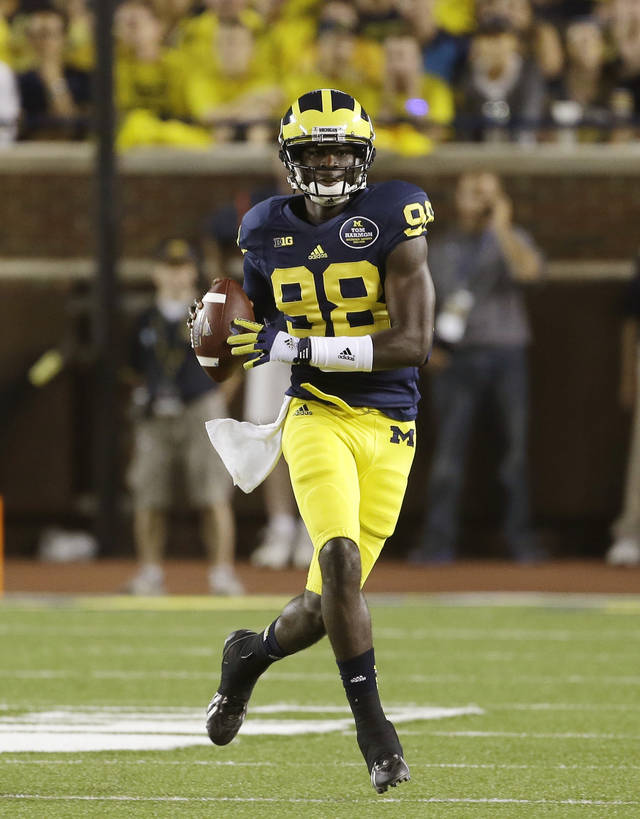 Michigan quarterback Devin Gardner (98) scrambles during the second quarter of an NCAA college football game against Notre Dame in Ann Arbor, Mich., Saturday, Sept. 7, 2013. (AP Photo/Carlos Osorio)