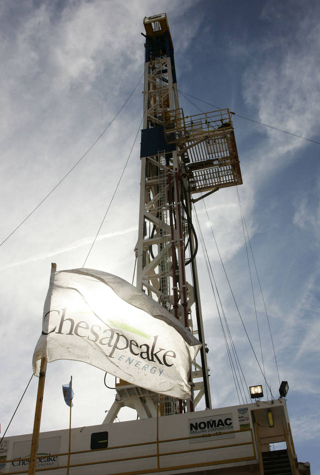 A Chesapeake drilling rig is shown Oct. 28, 2009, near Bessie.  AP Photo