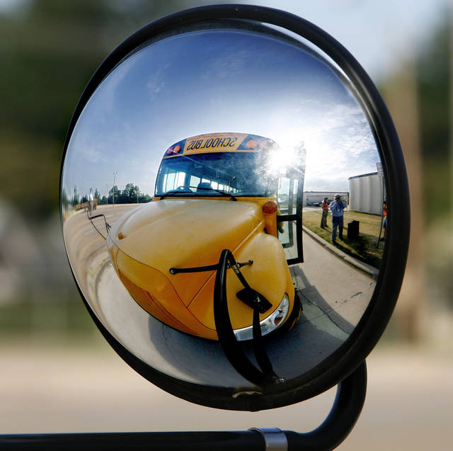 A school bus is  reflected in the bus' mirror at the school's transportation center Thursday,  Aug. 7, 2008.   BY JIM BECKEL, THE OKLAHOMAN