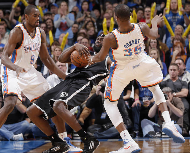 Oklahoma City's Kevin Durant (35) collides with Brooklyn Nets' Gerald Wallace (45) during the NBA basketball game between the Oklahoma City Thunder and the Brooklyn Nets at the Chesapeake Energy Arena on Wednesday, Jan. 2, 2013, in Oklahoma City, Okla. Photo by Chris Landsberger, The Oklahoman
