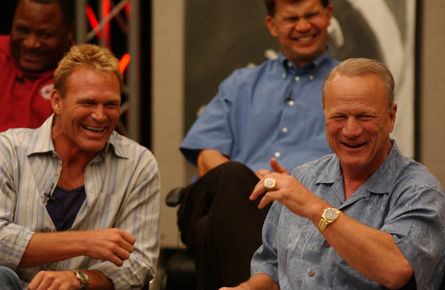 Sooner legends Brian Bosworth, Barry Switzer and Ken Mendenhall, back right, laugh it up during a 2003 reunion of former OU football players. OKLAHOMAN ARCHIVE PHOTO