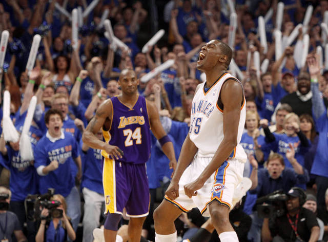 NBA PLAYOFFS / L.A. LAKERS / REACTION: Oklahoma City's Kevin Durant reacts in front of L.A.'s Kobe Bryant during the NBA basketball game between the Los Angeles Lakers and the Oklahoma City Thunder in game six of the first round series at the Ford Center in Oklahoma City, Friday, April 30, 2010. Photo by Bryan Terry, The Oklahoman ORG XMIT: KOD