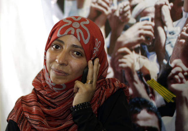Yemeni activist Tawakkul Karman speaks on the telephone after the announcement of the 2011 Nobel Peace Prize in Sanaa, Yemen, Friday, Oct. 7, 2011. The 2011 Nobel Peace Prize was awarded Friday to Liberian President Ellen Johnson Sirleaf, Liberian peace activist Leymah Gbowee and Tawakkul Karman of Yemen for their work on women's rights. (AP Photo/Hani Mohammed)