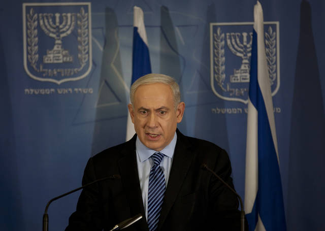 "Israel's Prime Minister Benjamin Netanyahu delivers a statement to the media at Hakirya a military base in Tel Aviv, Israel, Wednesday, Nov. 14, 2012. Israel's prime minister says the military is prepared to broaden its operation against Hamas targets in Gaza. Benjamin Netanyahu says Israel cannot tolerate continued rocket attacks against its citizens. In his first comments since Israel killed the commander of the Hamas military wing, Netanyahu said Wednesday that Israel is ""prepared to expand the operation"". (AP Photo/Ariel Schalit)"