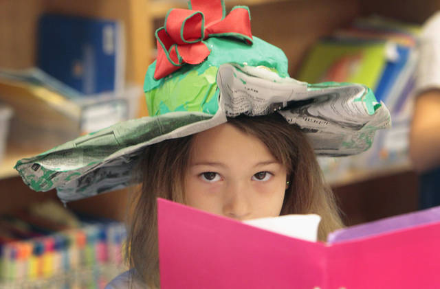 First-grader Gabriella Gasbarra wears a hat  she made from newspaper, painted green and adorned with a coin for luck  at Christ the King Elementary School to celebrate  St. Patrick's Day, Friday, March 16, 2012.  Photo By David McDaniel/The Oklahoman
