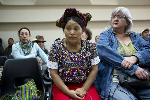 Elena de Paz, an Ixil Indian woman, center, attends the pre-trial hearing for Guatemala's former dictator Efrain Rios Montt (1982-1983) in a courtroom in Guatemala City, Wednesday, Jan. 23, 2013. A judge in Guatemala has begun pre-trial hearings in a genocide case against former dictator Efrain Rios Montt, who is accused of overseeing hundreds of killings when he ruled Guatemala from 1982 to 1983, at the height of the country's 36-year civil war. The war ended in peace accords in 1996, after 200,000 deaths. Elena de Paz is from the area where the alleged genocide took place. (AP Photo/Moises Castillo)
