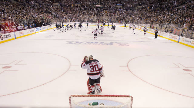 New Jersey Devils goalie Martin Brodeur (30) skates off the ice at the end of the game as the Los Angeles Kings celebrate their 6-1 Stanley Cup win during Game 6 of the NHL hockey Stanley Cup finals, Monday, June 11, 2012, in Los Angeles. (AP Photo/Mark J. Terrill)