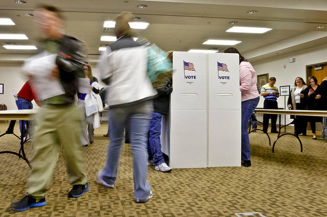 Voters file in to cast their vote during election day on Tuesday, Nov. 6, 2012, in Yukon, Oklahoma. Photo by Chris Landsberger, The Oklahoman