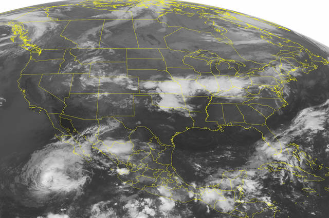 This NOAA satellite image taken Wednesday, Sept. 26, 2012, at 1:45 a.m. EDT shows areas of thunderstorms across the Ohio Valley into Missouri, Kansas and Oklahoma. In the northeast an area of rain and clouds moves over New York and New England. Father west, showers and mountain snow showers over the Rocky Mountains.(AP Photo/Weather Underground)