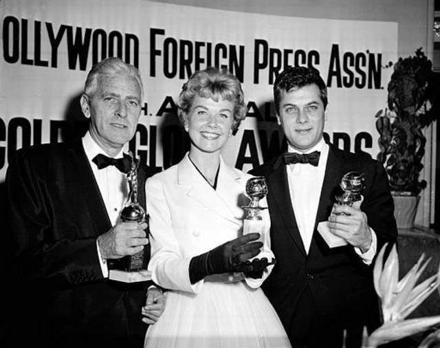Actress Doris Day, center, Tony Curtis, right, and Buddy Adler pose with their awards  presented to them by the Hollywood Foreign Press Association at its annual awards dinner in the Cocoanut Grove in Los Angeles, Ca., Feb. 26, 1958.  Day and Curtis were named best actress and actor in a poll conducted in 58 countries; Adler was presented the Cecil B. DeMille award by the association for outstanding contribution to the motion picture industry.  (AP Photo)