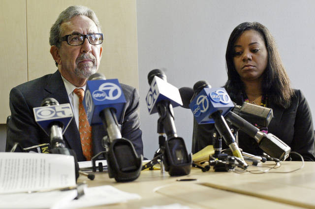Attorney Burton Boltuch, left, announces a sexual harassment lawsuit filed on behalf of plaintiff Erika Smith, right, against the Golden State Warriors' Monta Ellis, at Boltuch's office, Wednesday, Dec. 21, 2011, in Oakland, Calif. Smith, a former Golden State Warriors employee, filed the sexual harassment lawsuit against star guard Ellis on Wednesday, alleging Ellis sent her unwanted texts that included a photo of his genitals. (AP Photo/Bay Area News Group, Oakland Tribune, Laura A. Oda)