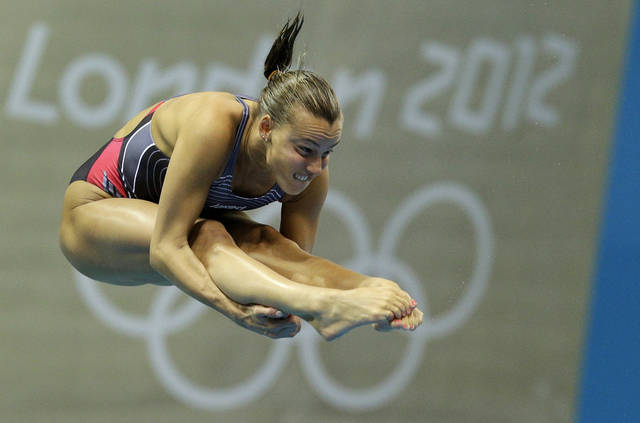 Tania Cagnotto from Italy competes during the women's 3-meter springboard diving semifinal at the Aquatics Centre in the Olympic Park during the 2012 Summer Olympics in London, Saturday, Aug. 4, 2012. (AP Photo/Michael Sohn)