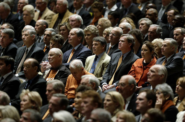 Texas Gov. Rick Perry, center, and others attend a public memorial for former Texas football coach Darrell K Royal, Tuesday, Nov. 13, 2012, in Austin, Texas. Royal, the coach who led Texas to two national championships and revolutionized college football with the introduction of the wishbone in 1968, died on Nov. 7 at age 88. (AP Photo/Eric Gay)