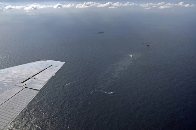 """This image taken Nov. 17, 2011 and released by Chevron oil company, shows an aerial view of vessels in the clean up of an oil spill in an offshore field operated by Chevron at the Bacia de Campos, in Rio de Janeiro state, Brazil. The oil spill off the Brazilian coast occurred because Chevron underestimated the pressure in an underwater reservoir, the head of the company's Brazil operations said Sunday. George Buck, chief operating officer for the Brazilian division of the San Ramon, California-based company, told foreign journalists that Chevron """"takes full responsibility for this incident,"""" and that """"any oil on the surface of the ocean is unacceptable to Chevron."""" (AP Photo/Ibama)"""