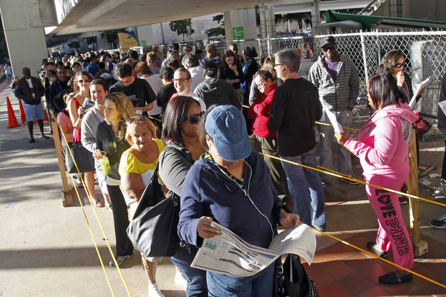 In this Nov. 3, 2012, photo, South Floridians stand in line during the last day of early voting in Miami. A judge extended early voting hours in one Florida county Sunday, Nov. 4, after Democrats sued to allow more time in a presidential battleground state where more than 4 million ballots have already been cast. The move was one of many legal skirmishes in the tight contest between Barack Obama and Mitt Romney to deal with inevitable disputes over balloting. Some Florida voters had stood in long lines Saturday, the last scheduled day of early voting. The judge ruled on a lawsuit filed late Saturday in Orange County after an early voting site was shut down for several hours. (AP Photo/Alan Diaz)