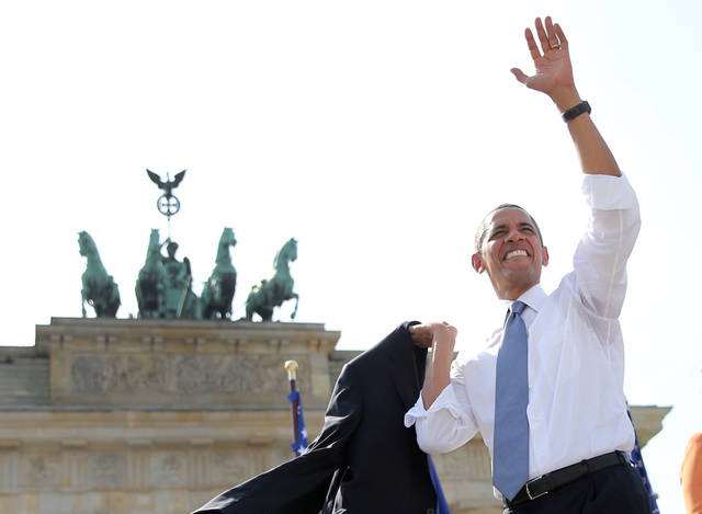 US President Barack Obama  waves to spectators before he  delivers a speech in front of the Brandenburg Gate  at Pariser Platz in Berlin, Germany,  Wednesday June 19, 2013.   On the second day of his visit to Germany, Obama met with German President Joachim Gauck and Chancellor Angela Merkel before delivering a speech at Brandenburg Gate. Atop of the gate the Quadriga sculpture.  ( AP  Photo/Michael Kappeler,Pool)