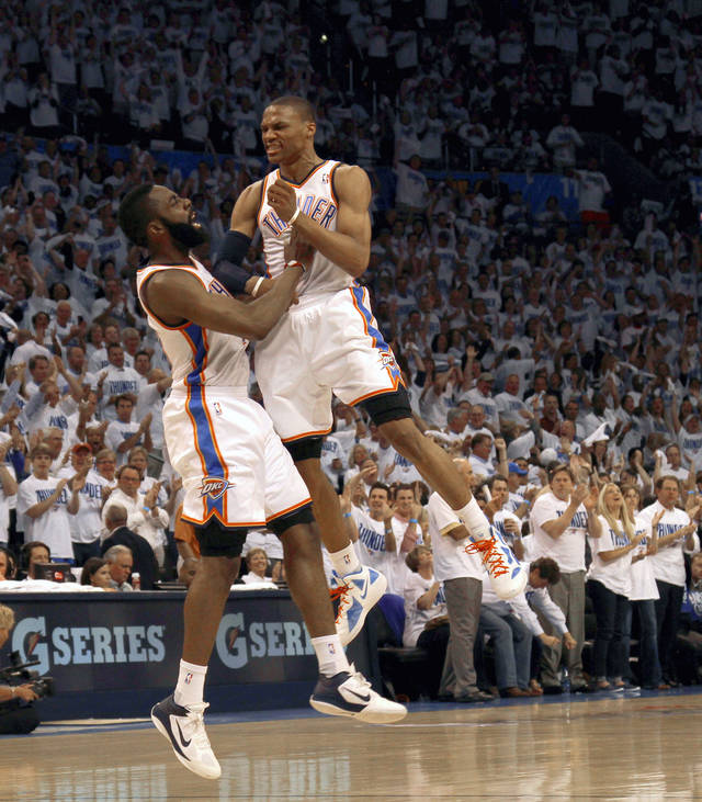 Oklahoma City's Russell Westbrook (0)  and James Harden (13) celebrate during game five of the Western Conference semifinals between the Memphis Grizzlies and the Oklahoma City Thunder in the NBA basketball playoffs at Oklahoma City Arena in Oklahoma City, Wednesday, May 11, 2011. Photo by Bryan Terry, The Oklahoman