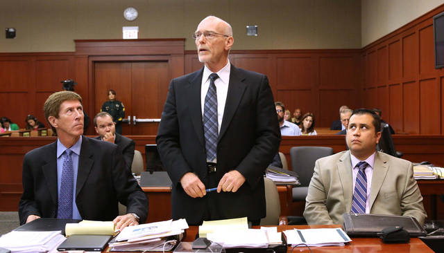 Defense attorney Don West, center, addresses the court as defense attorney Mark O'Mara, left, and defendant George Zimmerman listen, in Seminole circuit court during a pretrial hearing, in Sanford, Fla., Saturday, June 8, 2013. Zimmerman has been charged with second-degree murder for the 2012 shooting death of Trayvon Martin.(AP Photo/Orlando Sentinel, Joe Burbank, Pool)