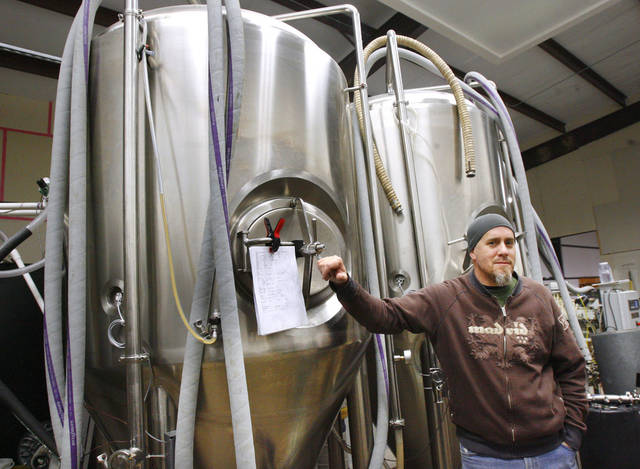 J.D. Merryweather, partner in Coop Ale Works, with the 500 gallon brewery tanks at Coop Ale Works in Oklahoma City Monday, Feb. 2, 2009. BY PAUL B. SOUTHERLAND, THE OKLAHOMAN