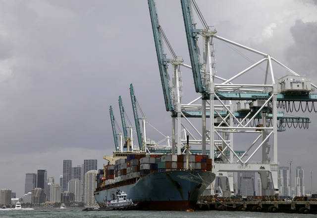 In this Friday, May 18, 2012, file photo, a Maersk freighter is loaded with shipping containers at the Port of Miami in Miami. The U.S. trade deficit narrowed in May from April, helped by cheaper oil that lowered imports and an increase in American exports to Europe and China. But economists cautioned that the global economy has weakened since then. And they noted that the decline in the deficit. (AP Photo/Lynne Sladky)