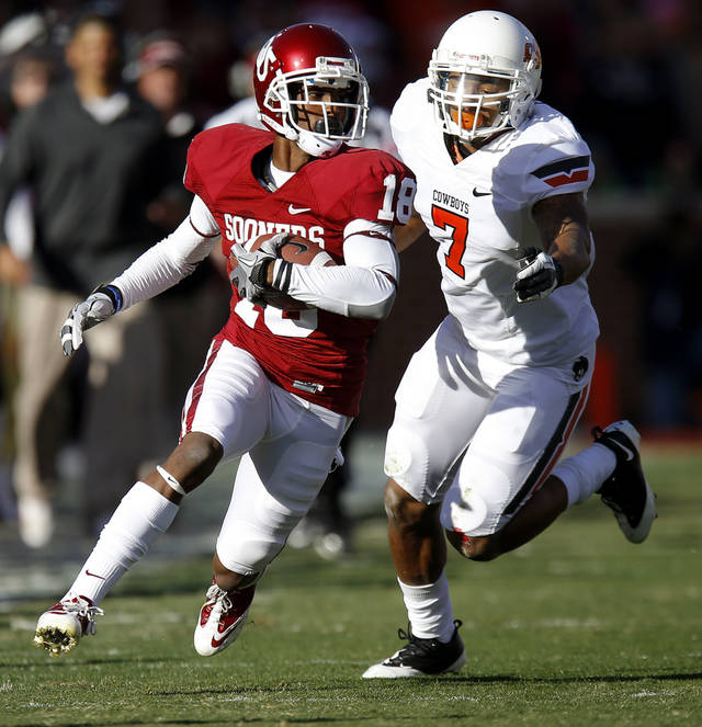 Oklahoma's Jalen Saunders (18) runs past Oklahoma State's Shamiel Gary (7) after a reception in the Bedlam college football game between the University of Oklahoma Sooners (OU) and the Oklahoma State University Cowboys (OSU) at Gaylord Family-Oklahoma Memorial Stadium in Norman, Okla., Saturday, Nov. 24, 2012. Oklahoma won 51-48. Photo by Bryan Terry, The Oklahoman