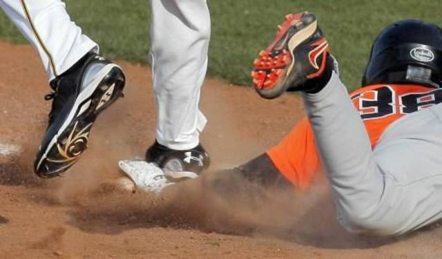 OSU's Davis Duren (38) has his hand stepped on by Phil McCormick (27) of Missouri as he touches first base in the top of the ninth inning during the Big 12 baseball tournament game between Oklahoma State University and the University of Missouri at RedHawks Field at Brickown in Oklahoma City, Thursday, May 26, 2011. Duren was called out on the play. Missouri won, 6-5. Photo by Nate Billings, The Oklahoman