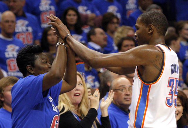 Oklahoma City's Kevin Durant (35) high fives his mom Wanda Pratt during Game 5 in the second round of the NBA playoffs between the Oklahoma City Thunder and the L.A. Lakers at Chesapeake Energy Arena in Oklahoma City, Monday, May 21, 2012. Photo by Sarah Phipps, The Oklahoman