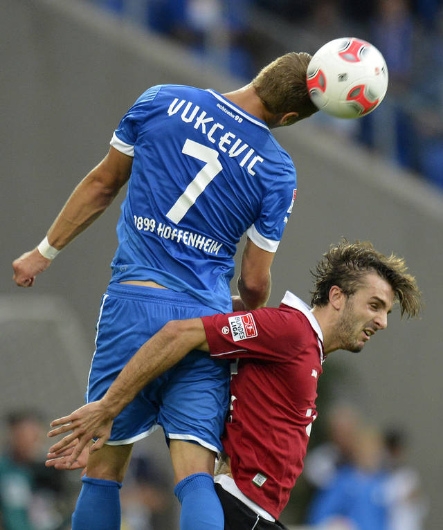 Hoffenheim's Boris Vukcevic, left, and Hannovers Adrian Nikci go for a header during the German first division Bundesliga soccer match between TSG 1899 Hoffenheim and Hannover 96 in Sinsheim, Germany, Sunday, Sept. 23, 2012. (AP Photo/dapd, Ronald Wittek)